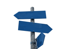 A signpost with three blue arrow-shaped signs pointing in different directions.